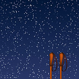Winter background with old ski poles