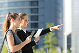 Businesswomen searching location with mobile gps and map