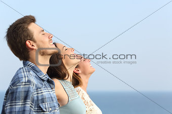Group of friends breathing deep fresh air