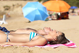 Sunbather couple sunbathing on the beach