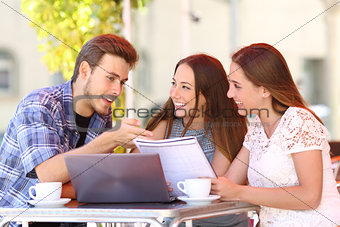 Three students studying and learning in a coffee shop