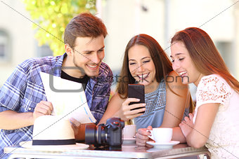 Tourist friends planning vacation with gps phone