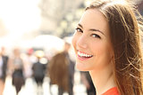 Woman face smile with perfect teeth looking you