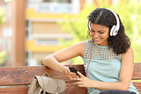 Woman listening to the music in a park