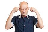 Young bald man thinking too hard