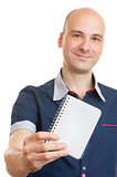 bald man showing a blank notepad