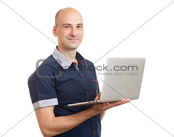 smiling bald young man with laptop