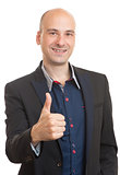happy bald businessman shows thumbs up