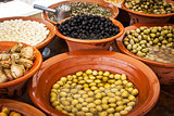 Different marinated olives and local food on spanish street mark
