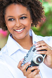 Mixed Race African American Girl With Camera