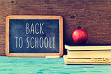 text back to school written on a chalkboard, cross processed