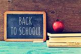 text back to school written on a chalkboard, cross processed