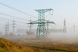 High-voltage power line against autumn landscape
