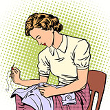 woman sews shirt thread housewife housework comfort