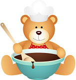 Cook teddy bear with bowl of chocolate