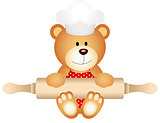 Teddy bear holding rolling pin
