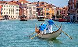 Gondolier gondola on Grand canal Venice italy