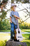 portrait of a little boy with guitar