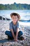 portrait of a little boy wearing hat