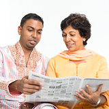 Indian family reading newspaper