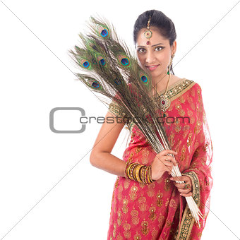 Beautiful Indian woman with peacock feathers