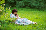 Mother play with baby son summer