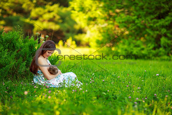 Mom feeds the baby, breastfeeding,summer