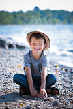 portrait of a little boy wearing hat