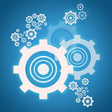 Cog wheels on blue background
