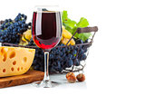 Glass red wine with grapes and cheese