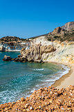 Golden beach and coastline at the Greek island of Milos