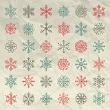 Vector Winter Snow Flakes Doodles on Crumpled Paper