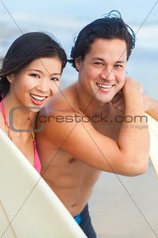 Asian Man Woman Couple Surfboards on Beach
