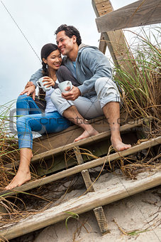 Asian Man Woman Couple Drinking Coffee on Beach Steps
