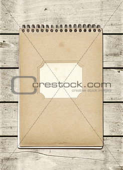 Closed spiral Note book on a white wood table