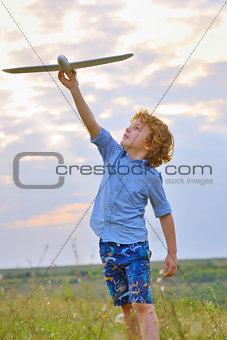 boy throwing airplane