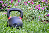 heavy kettlebell in backyard