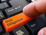 Due Diligence - Written on Orange Keyboard Key.