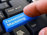 Press Button Conversion Marketing on Black Keyboard.