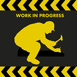 WORK IN PROGRESS sign with worker silhouette