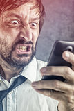 Angry businessman received frustrating SMS message