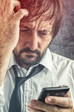 Worried businessman received bad news SMS message