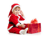 Christmas baby with gift box in Santa's suit isolated
