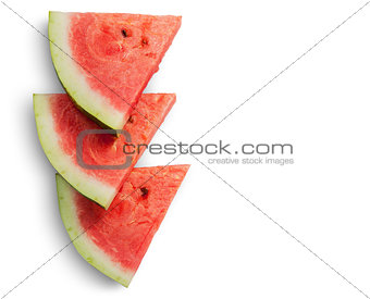 Three slices of watermelon on each other