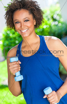 African American Woman Exercising With Weights Outside