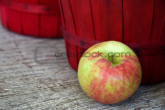 apple with red basket