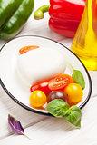 Mozzarella, tomatoes, basil and olive oil