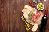 Prosciutto, wine, olives, parmesan and olive oil