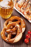 Pretzel, beer mug and grilled shrimps