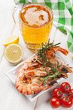 Beer mug and grilled shrimps